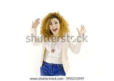 Scared face of woman white background. Looking at camera. Portrait of scared shocked afraid frightened curly girl in pink jacket. - stock photo