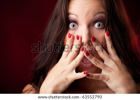 Scared face of women in the dark - stock photo