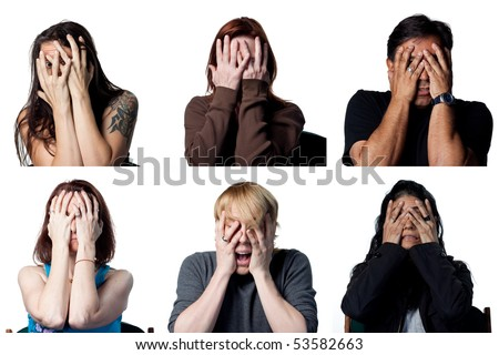 Scared folks covering their faces with their hands - stock photo