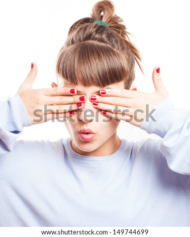 scared girl covering her eyes on a white background - stock photo
