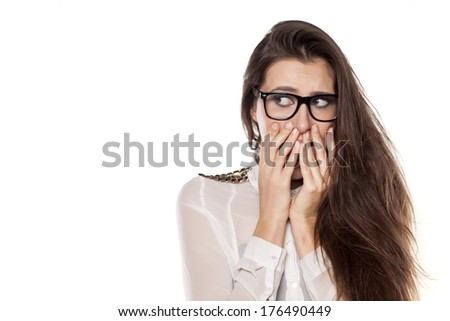scared girl posing on a white background - stock photo