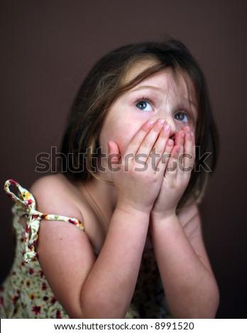 Scared little girl - stock photo