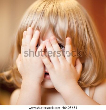 Scared little girl, shallow DOF, focus on eye - stock photo