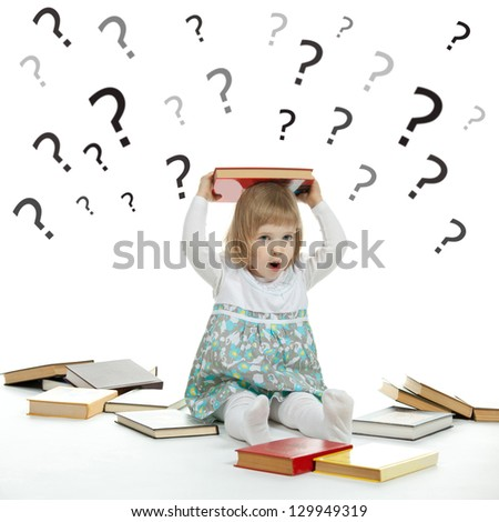 Scared little girl sitting on the floor surrounded by books and question marks - stock photo