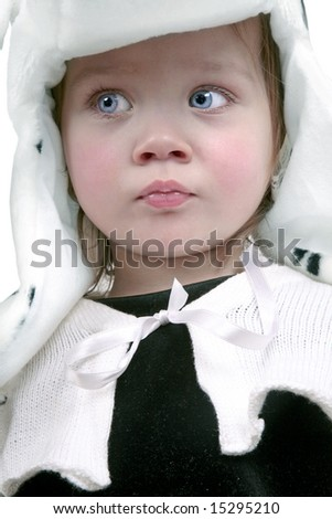 Scared looking cute little baby girl - stock photo
