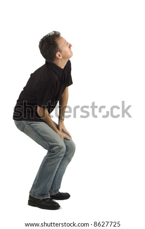 Scared man against a white background, looking up. - stock photo