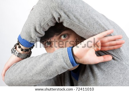 scared man that covers his face with the hands - stock photo