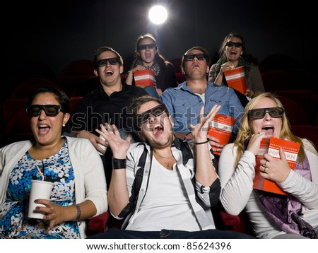 Scared Movie spectators with 3d glasses - stock photo