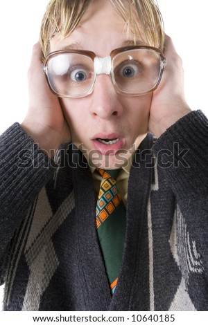 Scared nerd with funny glasses looking at camera and covering his ears. Front view, white background - stock photo
