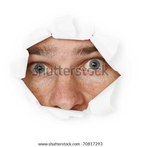 Scared person hiding in hole - stock photo
