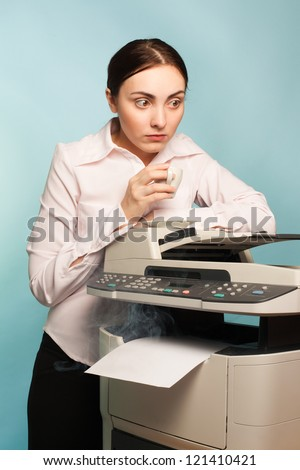 Scared secretary with coffee and smoking copier - stock photo