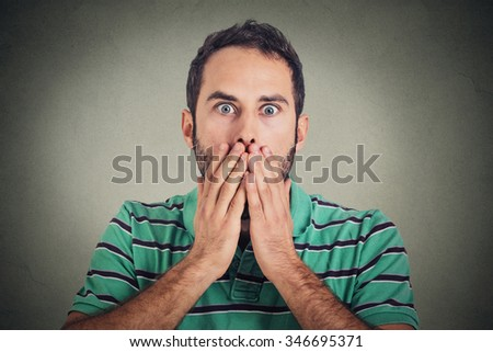 Scared stunned shocked young man  - stock photo