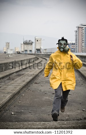 Scared worker running from something - stock photo