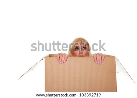 Scared young blonde emerging from a box isolated on white - stock photo