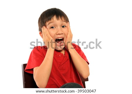 Scared young boy on pure white background - stock photo