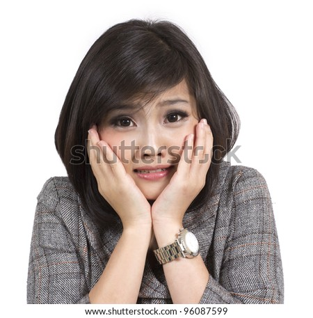 scared young business woman on white background