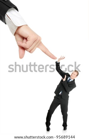 Scared young businessman afraid of big hand, isolated on white - stock photo