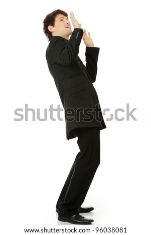 Scared young businessman, isolated on white - stock photo