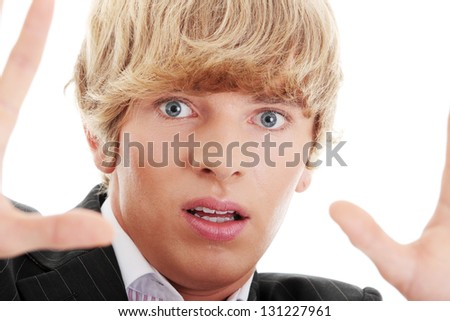 Scared young businessman on white background - stock photo
