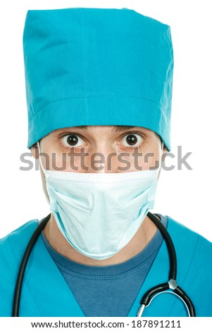 scared young doctor(nurse, student) wearing scrubs  - stock photo