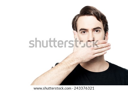 Scared young man with hand cover his mouth - stock photo