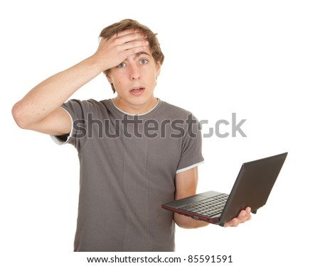 scared young man working on laptop, white background, series