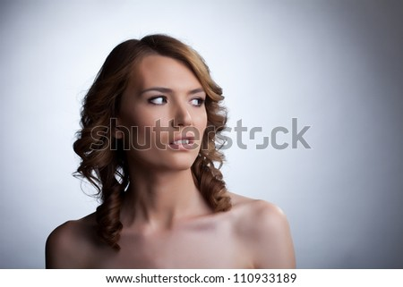 Scared young woman looking away - stock photo