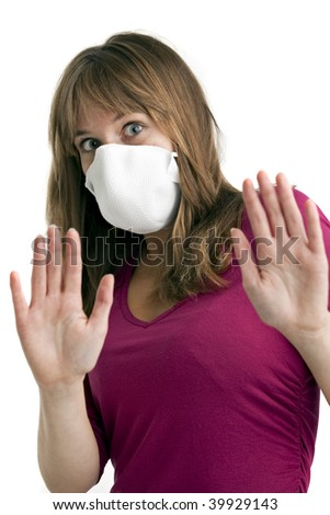 scared young woman wearing a protective mask to protect her from swine flu