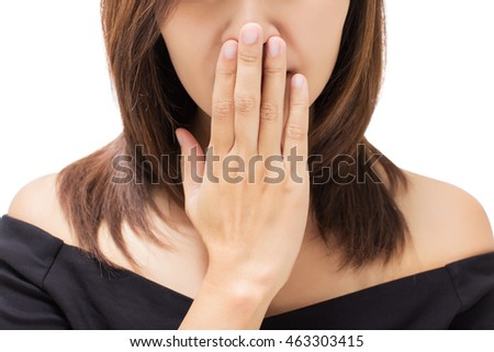 Scared young woman with her hand on her mouth