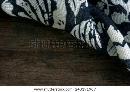 scarf on wooden background - stock photo