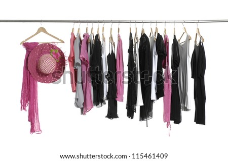 Scarf with hat and fashion colorful clothing hanging a on display - stock photo