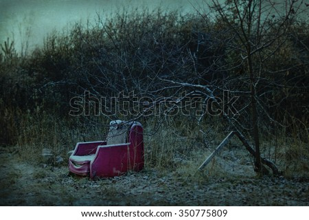 scary abandoned armchair - stock photo