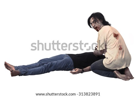 Scary asian male zombie eating corpse isolated over white background - stock photo