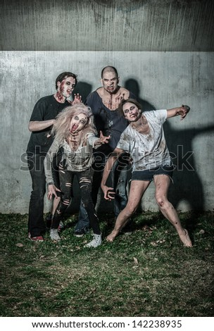 scary bloody zombies waiting for a prey - stock photo
