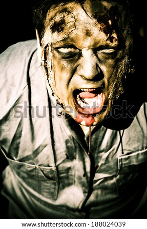 Scary dark horror portrait of an evil zombie screaming out in bloody fear - stock photo