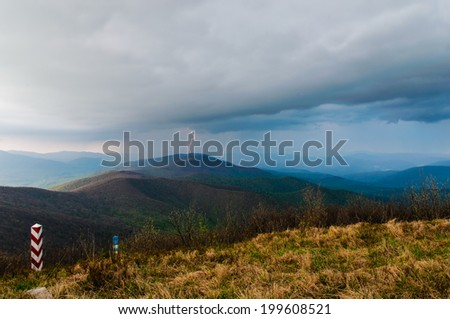 Scary evening in the top of Bieszczady mountains in the middle of thunderstorm full of flashlight and lightnings - stock photo