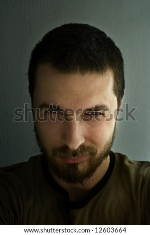 Scary face of evil man - stock photo