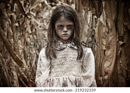 Scary Girl in a Corn Field - stock photo