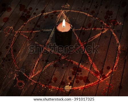 Scary Halloween collage with black candle, blood drops and pentagram circle on wooden table. Dark magic ritual with occult and esoteric symbols. - stock photo