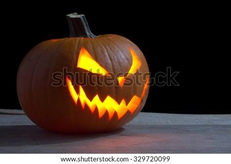 Scary halloween dark background on wood with jack o lantern - stock photo