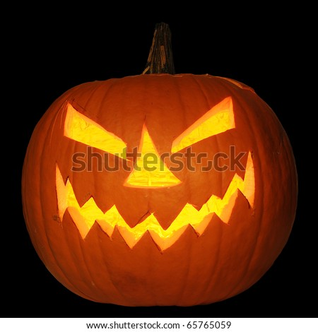 Scary halloween pumpkin jack-o-lantern candle lit, isolated on black background - stock photo