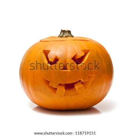 Scary Halloween pumpkin lantern isolated on a white studio background.