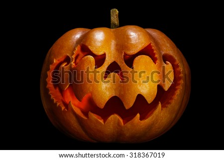Scary Halloween pumpkin resembling a Chinese dragon head, isolated on black - stock photo