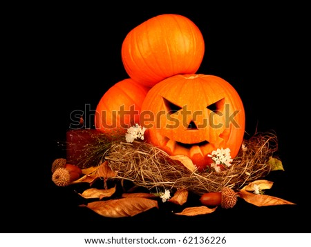 Scary halloween pumpkins isolated on black background - stock photo