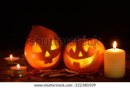 Scary halloween pumpkins  jack-o-lantern on black background - stock photo