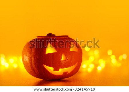 Scary halloween pumpkins jack-o-lantern with blur background - stock photo
