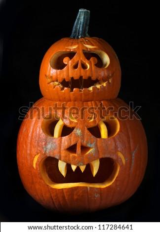 Scary Halloween pumpkins Jack O Lanterns isolated on black background - stock photo