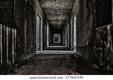 scary hallway walkway in abandoned building - stock photo