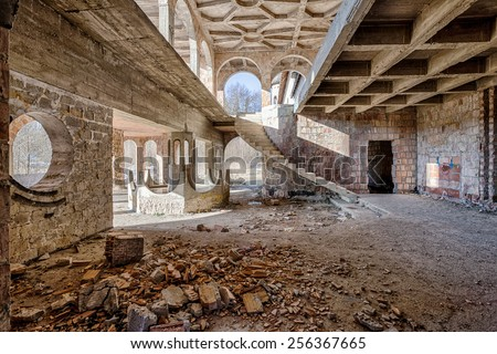 Scary interior in an abandoned, unfinished castle - stock photo