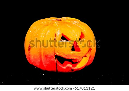 Scary Jack O Lantern Halloween Pumpkin Isolated on Black Background